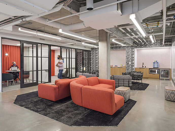 lounge space, red couches, private offices