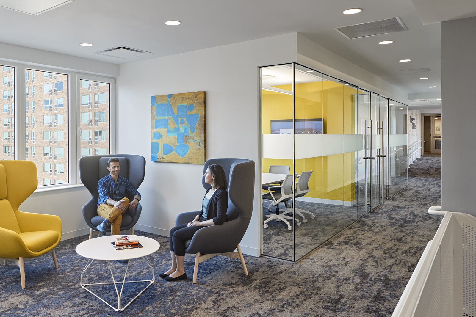 lounge chairs, glass walls, conference rooms