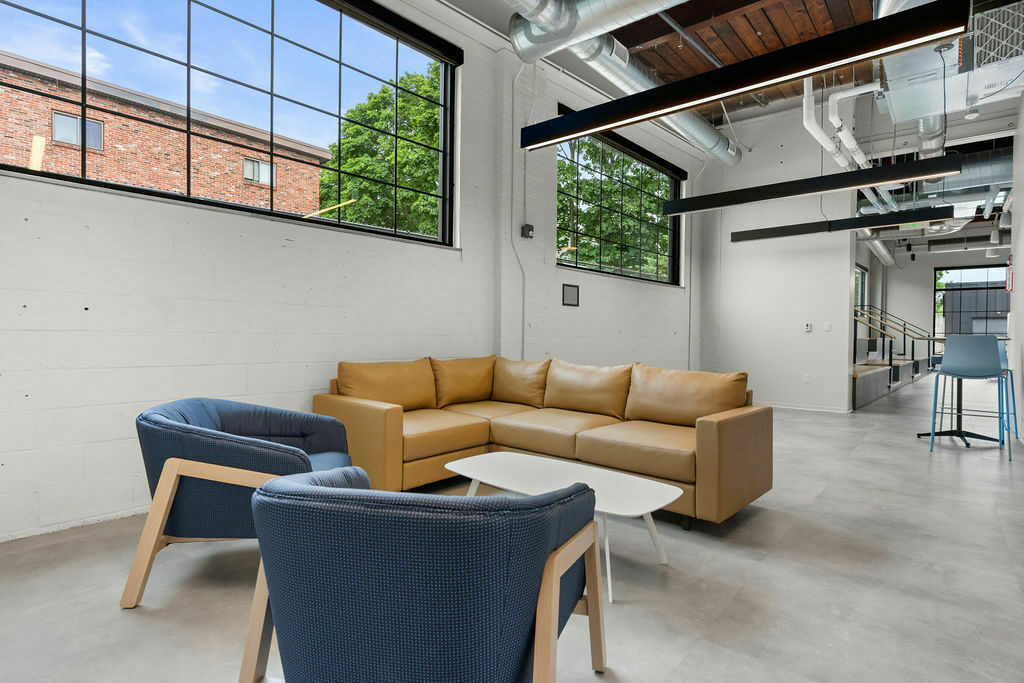 sofa and lounge chairs in open common area