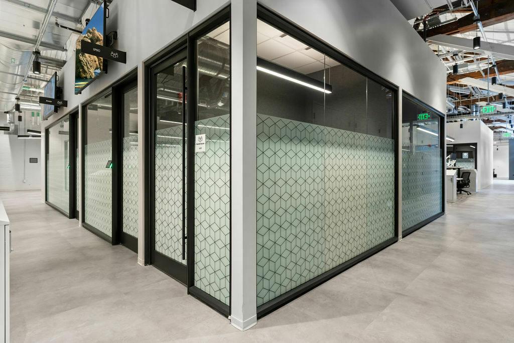 DIRTT glass walls with design
