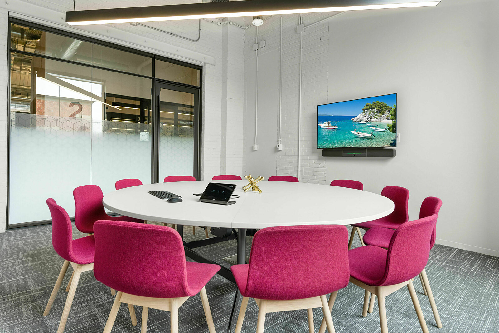 round white table with pink upholstered chairs